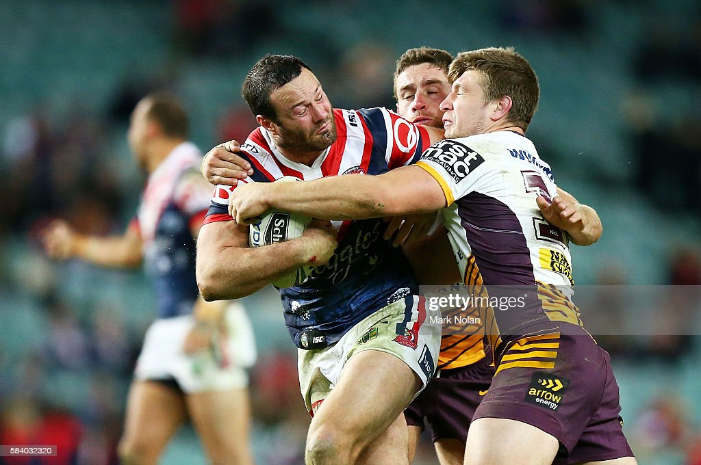 Boyd Cordner of the Roosters is tackled during the round 21 NRL match between the Sydney Roosters and the Brisbane Broncos at Allianz Stadium on July 28, 2016 in Sydney, Australia.