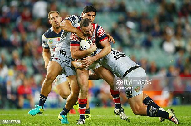 Boyd Cordner of the Roosters is tackled during the round 23 NRL match between the Sydney Roosters and the North Queensland Cowboys at Allianz Stadium...
