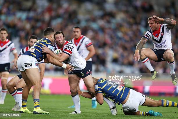 Boyd Cordner of the Roosters is tackled during the round 25 NRL match between the Parramatta Eels and the Sydney Roosters at ANZ Stadium on September...