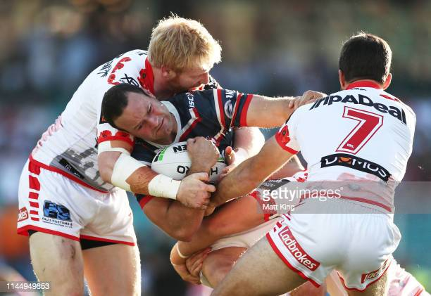 Boyd Cordner of the Roosters is tackled during the round 7 NRL match between the Sydney Roosters and the St George Illawarra Dragons at the Sydney...