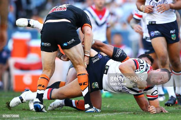 Boyd Cordner of the Roosters is tackled during the round one NRL match between the Wests Tigers and the Sydney Roosters at ANZ Stadium on March 10...