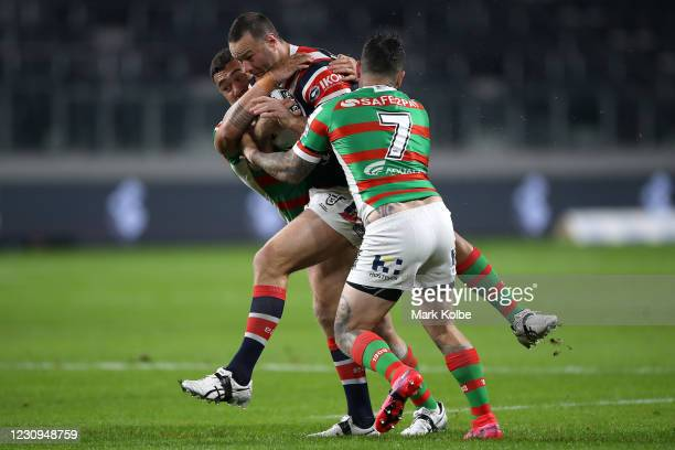 Boyd Cordner of the Roosters is tackled during the round three NRL match between the Sydney Roosters and the South Sydney Rabbitohs at Bankwest...