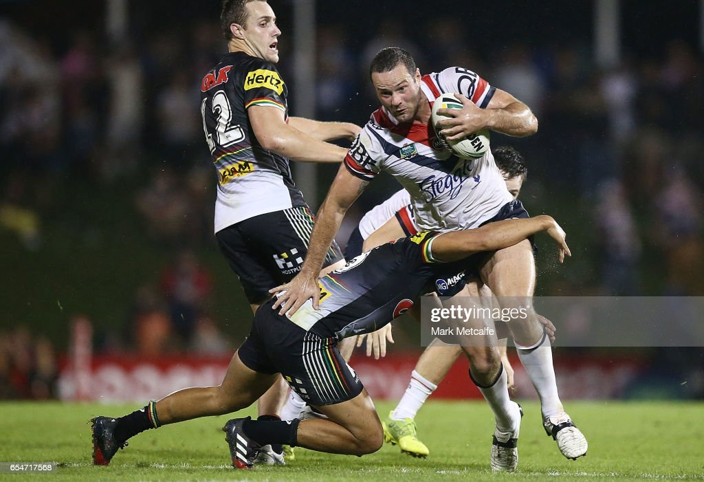 Boyd Cordner of the Roosters is tackled during the round three NRL match between the Penrith Panthers and the Sydney Roosters at Pepper Stadium on March 18, 2017 in Sydney, Australia.
