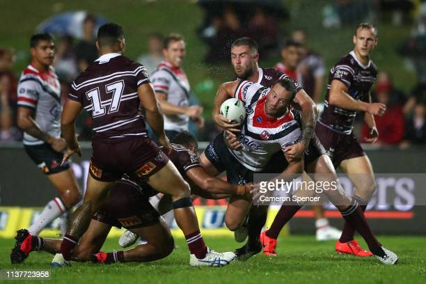 Boyd Cordner of the Roosters is tackled during the round two NRL match between the Manly Sea Eagles and the Sydney Roosters at Lottoland on March 23...