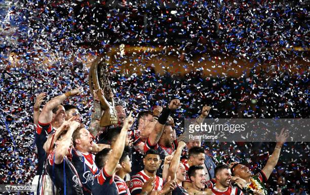 Boyd Cordner of the Roosters lifts the Premiership Trophy during the 2019 NRL Grand Final match between the Canberra Raiders and the Sydney Roosters...
