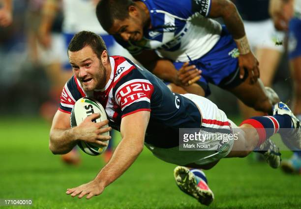 Boyd Cordner of the Roosters scores a try during the round 15 NRL match between the Canterbury Bulldogs and the Sydney Roosters at ANZ Stadium on...
