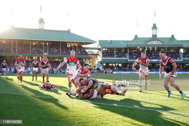 Boyd Cordner of the Roosters scores a try during the round 18 NRL match between the Sydney Roosters and the Newcastle Knights at Sydney Cricket...