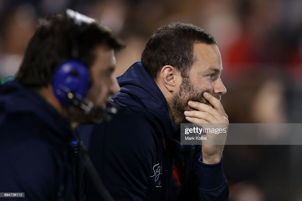 Boyd Cordner of the Roosters watches on from the bench during the round 14 NRL match between between the Wests Tigers and the Sydney Roosters at Campbelltown Sports Stadium on June 11, 2017 in Sydney, Australia.