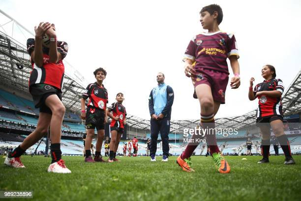Boyd Cordner takes part in a juniors coaching clinic during the New South Wales Blues State of Origin Team Announcement at ANZ Stadium on July 2 2018...