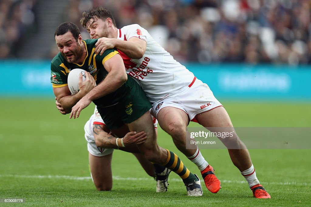 Boyd Corner of Australia is tackled by Elliott Whitehead of England during the Four Nations match between the England and Australian Kangaroos at Olympic Stadium on November 13, 2016 in London, United Kingdom.