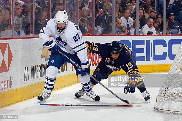 Boyd Devereaux of the Toronto Maple Leafs battles for the puck against Tim Connolly of the Buffalo Sabres on March 27 2009 at HSBC Arena in Buffalo...