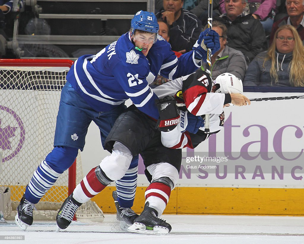 Boyd Gordon #15 of the Arizona Coyotes battles against James van Riemsdyk #21 of the Toronto Maple Leafs during an NHL game at the Air Canada Centre on October 26, 2015 in Toronto, Ontario, Canada. The Coyotes defeated the Leafs 4-3.