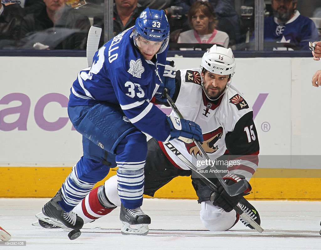 Boyd Gordon #15 of the Arizona Coyotes battles against Mark Arcobello #33 of the Toronto Maple Leafs during an NHL game at the Air Canada Centre on October 26, 2015 in Toronto, Ontario, Canada. The Coyotes defeated the Leafs 4-3.