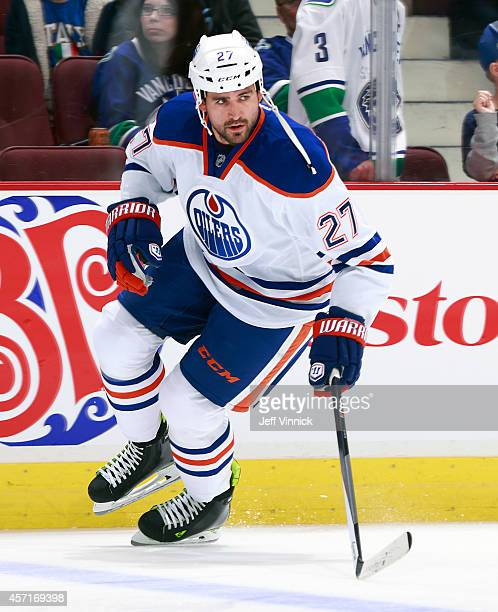Boyd Gordon of the Edmonton Oilers skates up ice during their NHL game against the Vancouver Canucks at Rogers Arena October 11, 2014 in Vancouver,...