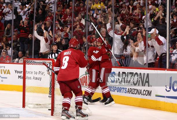 Boyd Gordon of the Phoenix Coyotes celebrates with Keith Yandle and Gilbert Brule after Gordon scored a first period goal against the Chicago...