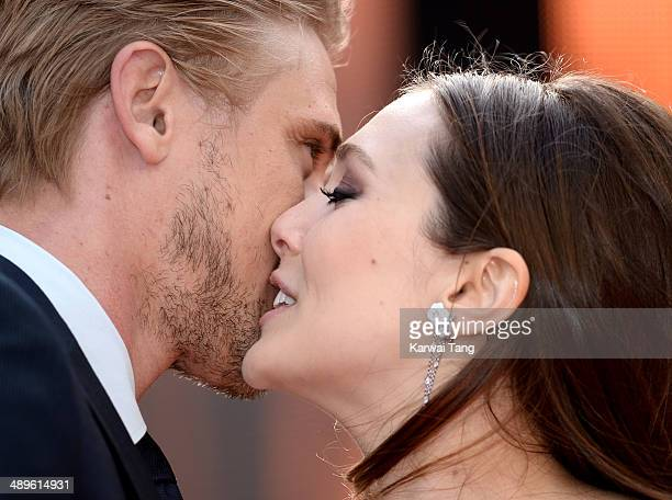 Boyd Holbrook and Elizabeth Olsen attend the European premiere of 'Godzilla' held at the Odeon Leicester Square on May 11 2014 in London England