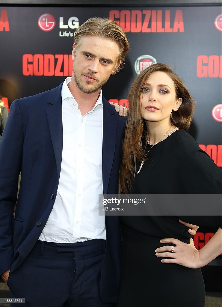 Boyd Holbrook and Elizabeth Olsen attend the 'Godzilla' Los Angeles premiere on May 8, 2014 in Hollywood, California.