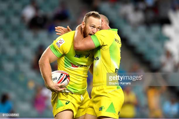 Boyd Killingworth of Australia celebrates scoring a try in the match against the USA during day one of the 2018 Sydney Sevens at Allianz Stadium on...