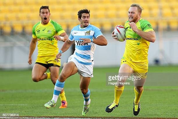 Boyd Killingworth of Australia makes a break from Rodrigo Etchart of Argentina during the 2016 Wellington Sevens plate final match between Argentina...