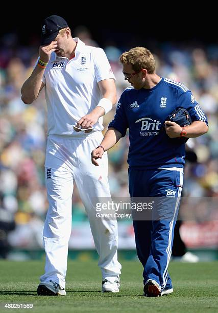 Boyd Rankin of England leaves the field for the econd time after picking up a injury during day one of the Fifth Ashes Test match between Australia...