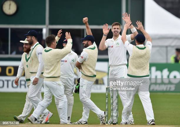 Boyd Rankin of Ireland is congratulated by team mates after taking the wicket of Haris Sohail of Pakistan during the fifth day of the international...