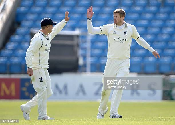 Boyd Rankin of Warwickshire celebrates with Sam Hain after dismissing Yorkshire captain Andrew Gale during day three of the LV County Championship...