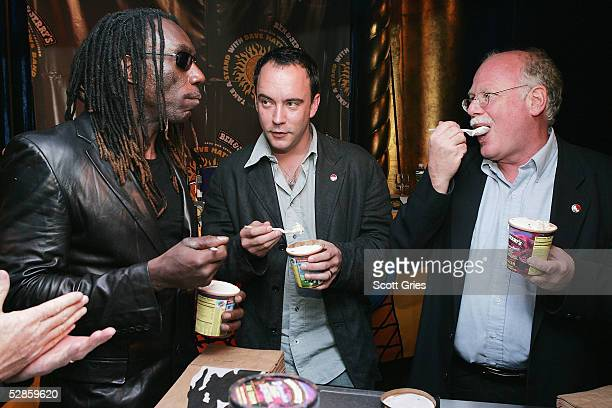 Boyd Tinsley and Dave Matthews of The Dave Matthews Band and cofounder of Ben Jerrys Ice Cream Ben Cohen eat ice cream during a press conference to...