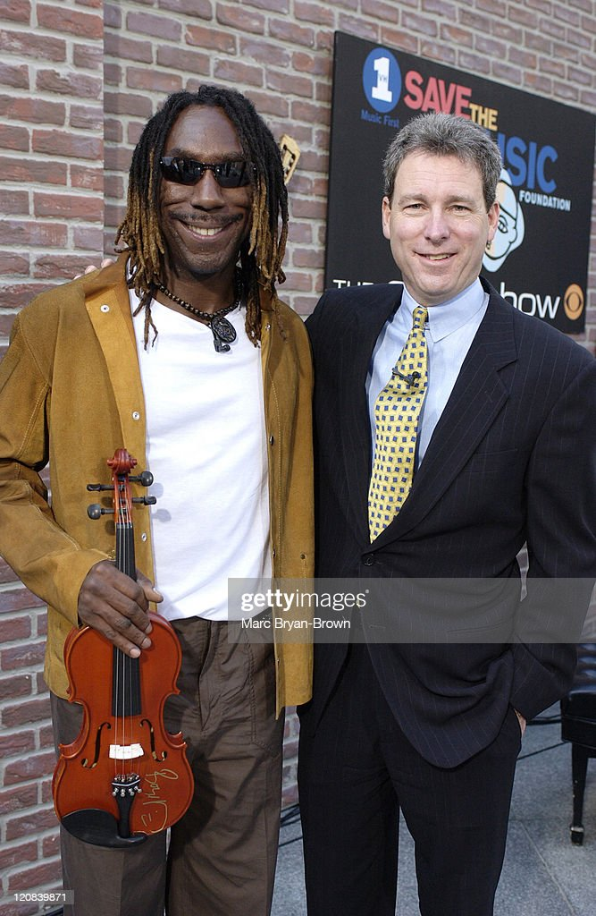 Boyd Tinsley of the Dave Matthews Band with John Hayes of American Express