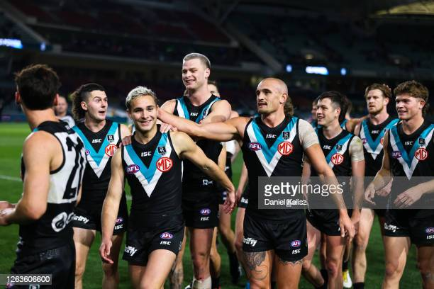 Boyd Woodcock of the Power celebrates with his team mates during the round 10 AFL match between the Port Adelaide Power and the Western Bulldogs at...