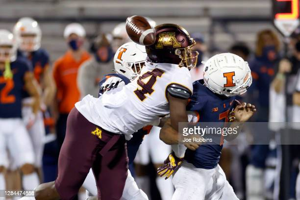 Boye Mafe of the Minnesota Golden Gophers sacks Coran Taylor of the Illinois Fighting Illini causing a fumble in the fourth quarter of the game at...