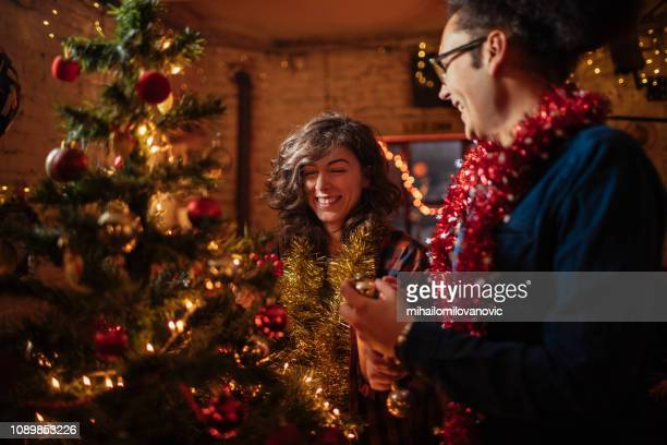 Boyfriend and Girlfriend decorating Christmas tree