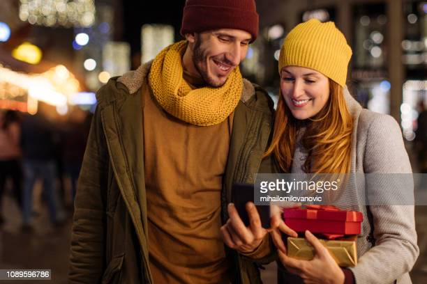 Boyfriend and girlfriend looking at smartphone