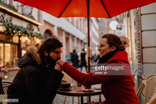 boyfriend and girlfriend sitting in the street cafe on a winter day - heidelberg germany stock pictures, royalty-free photos & images