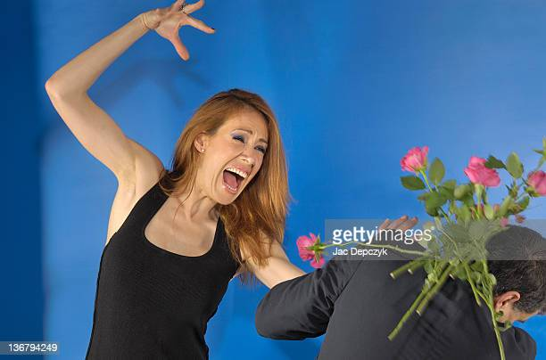 boyfriend gets thrashed with his bouquet of roses - depczyk stock pictures, royalty-free photos & images