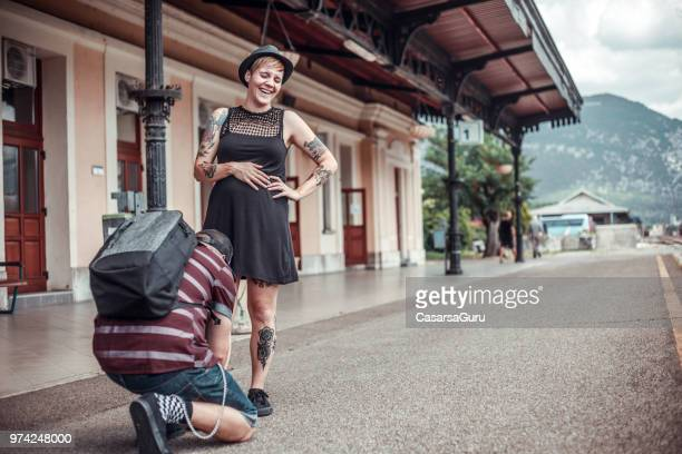 boyfriend tying shoelace for pregnant girlfriend - doing a favor stock pictures, royalty-free photos & images