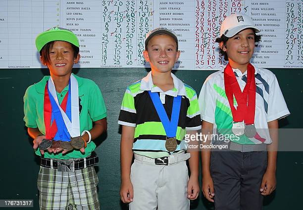 Boys 1011 age group drive contest top three finishers Leo Cheng third place Adam Moss first place and Sebastian Abasolo second place pose for a...