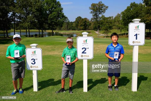 Boys 1011 Putt winners Matthew Lim Jake Cesare and Konnor Kueper pose during the Drive Chip and Putt Championship at The Honors Course on September...