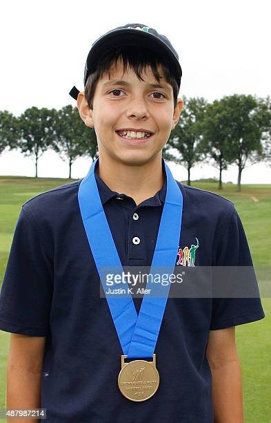 Boys 1213 driving winner Isaiah Swan poses for photos during the regional round of Drive Chip and Putt Championship at Oakmont Country Club on...