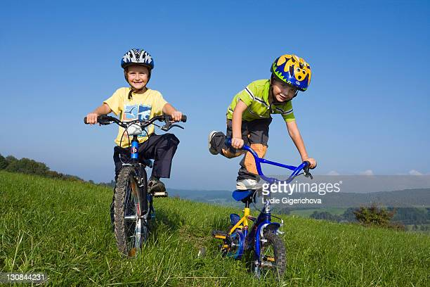 Boys, 6 and 4 years, on bikes