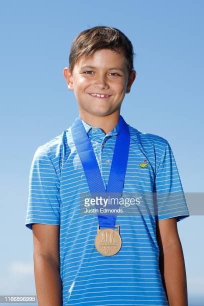 Boys 7-9 division winner Chase Hughes poses with his medal during the regional round of the Drive, Chip and Putt Championship at Colorado Golf Club...