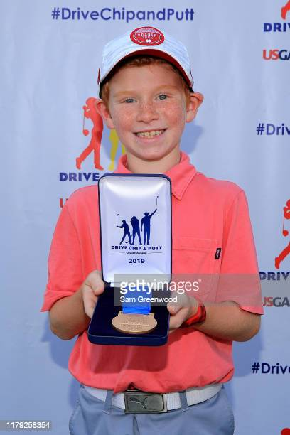 Boys 7-9 overall champion, Porter Hart, poses with his medal during a regional round for The Drive, Chip and Putt Championship at The Alotian Club on...