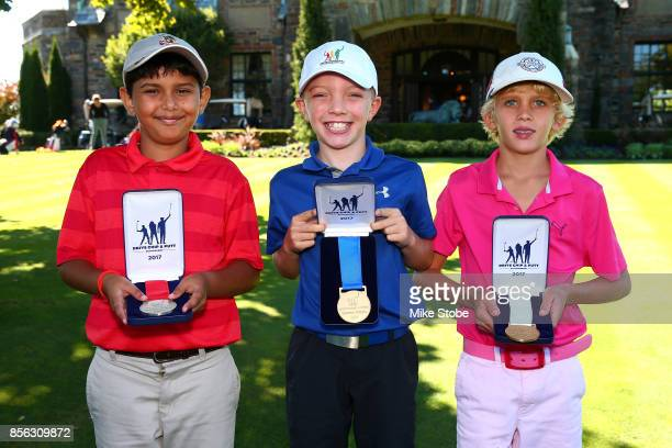 Boys 79 Overall winners Arav Rathore Landon Kelly and Brooks Colton pose during the Drive Chip and Putt Championship at Winged Foot Golf Club on...