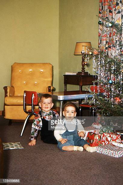 boys and Christmas tree in living room 1953, retro