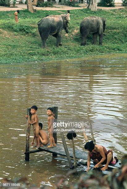 Boys and elephants in Siem Reap in northwestern Cambodia 1968