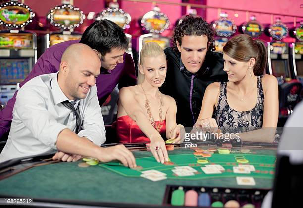boys and girls playing poker, black jack in casino