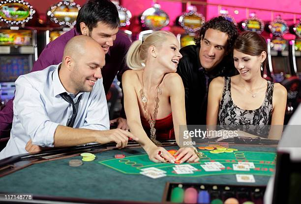 boys and girls playing poker,black jack  in casino