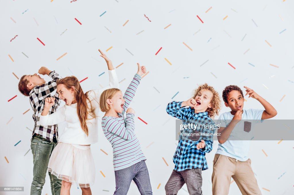 Boys and girls singing : Stock Photo
