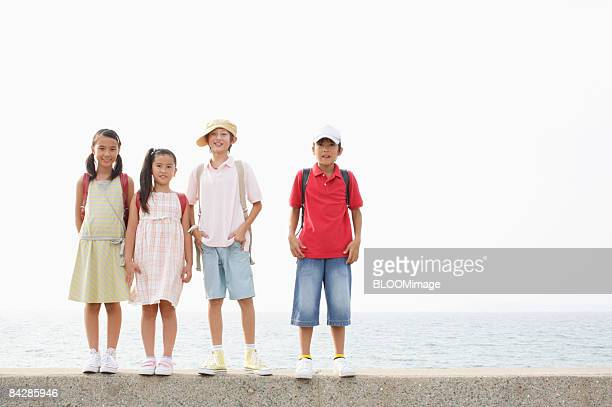 Boys and girls standing on floodwall