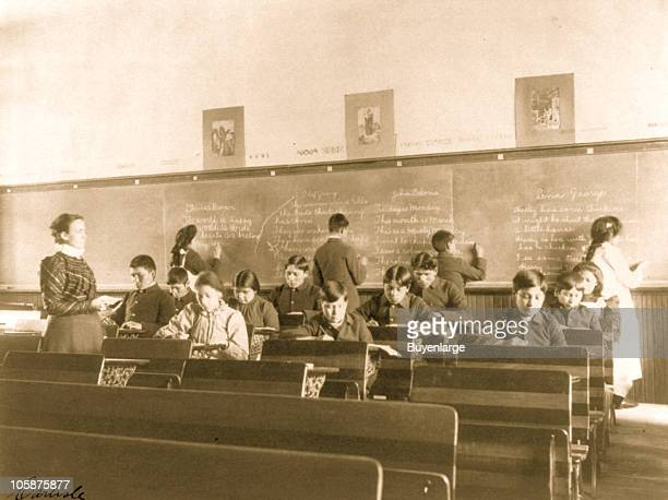 Boys and girls take a class in English or penmanship at the Carlisle Indian School Carlisle PA 1901