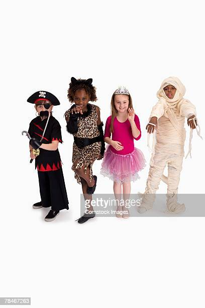 Boys and girls wearing costumes